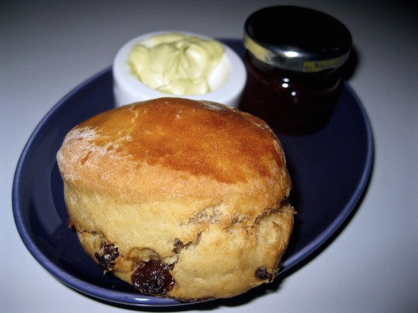 Classic sultana scone with jam and clotted cream