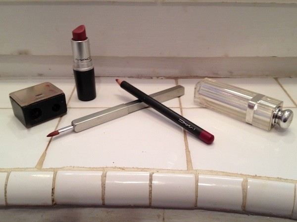 sharpener, lipstick, brush and pencil