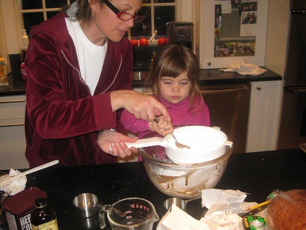 My cousins Nancy and Drew dumping ingredients in a bowl together