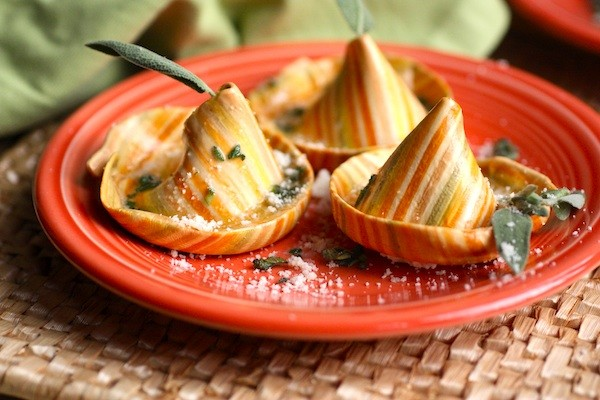 Hat shaped pasta stuffed with ricotta, goat cheese, sun-dried tomatoes in a sage butter sauce