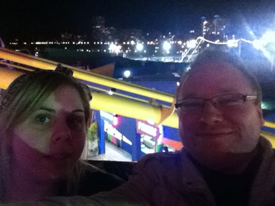 Tatjana and Aaron up high over Santa Monica Pier on the ferris wheel