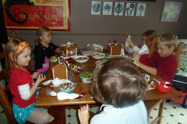 Daughter Holly and friends having a gingerbread party around the table