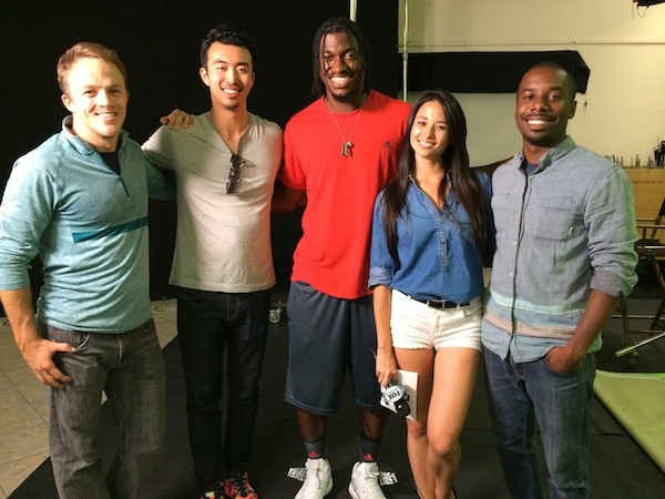 Aja and her crew on set with Washington Red Skin Robert Griffin III