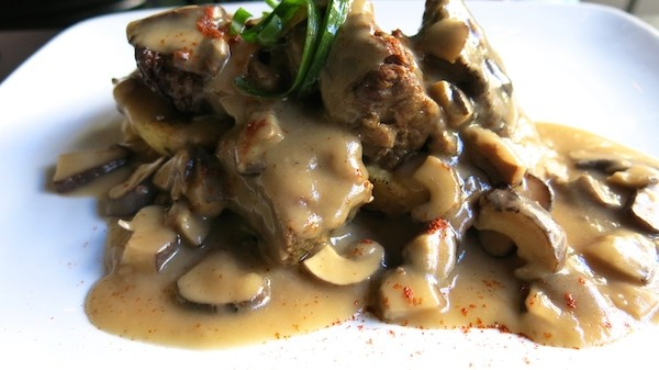 Boneless Beef Shortrib with Buttemilk Biscuit, housemade Scrapple, and Wild Mushroom Gravy